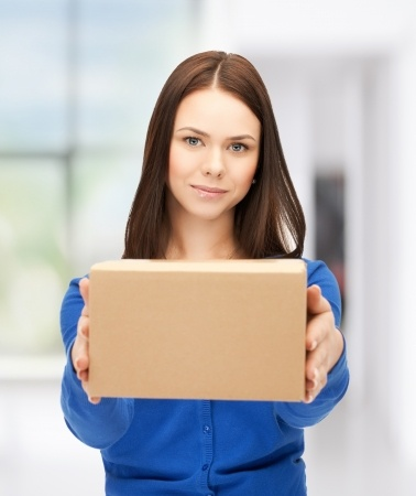 picture of woman handing box back